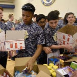 Middle schoolers fete veterans, send gift boxes