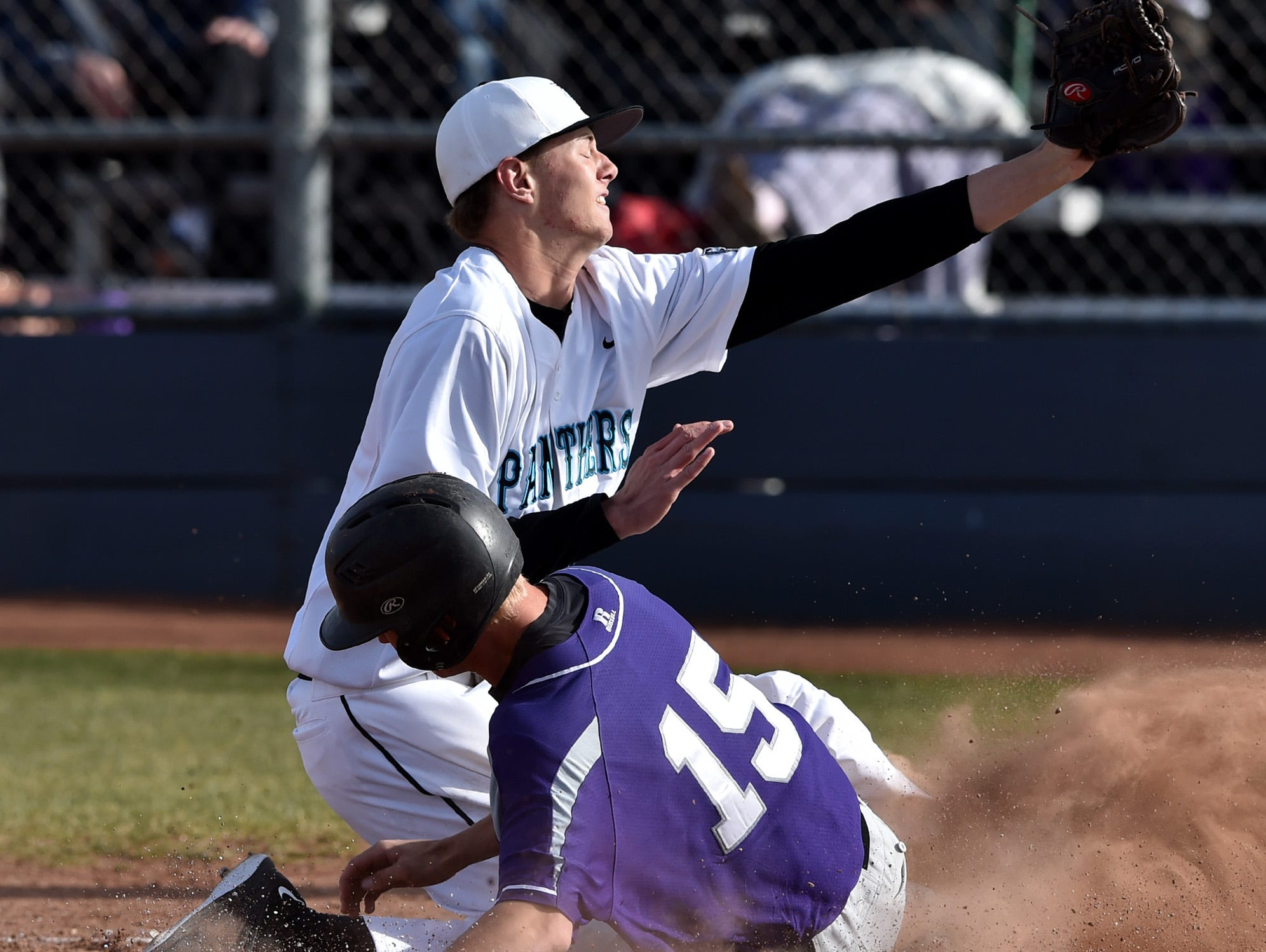 Spanish Spring's Alan Lummel steals home on a wild pitch by North Valley's Sean Flanary who attempts redeem himself but misses the catch Thursday at North Valleys.