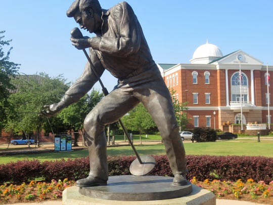 "The ""Homecoming Statue"" of Elvis Presley in front of Tupelo City Hall in Mississippi."