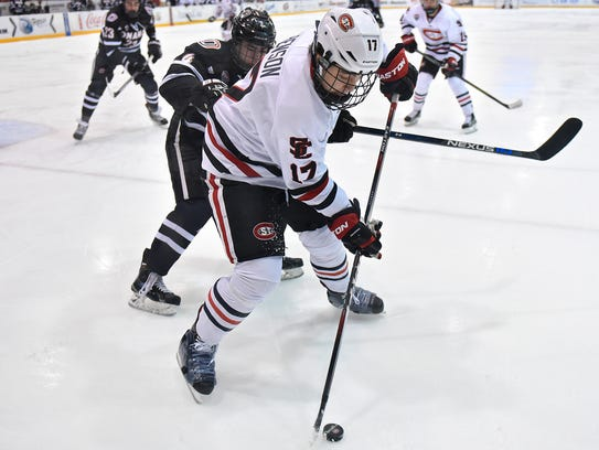 St. Cloud State's Jacob Benson works along the boards