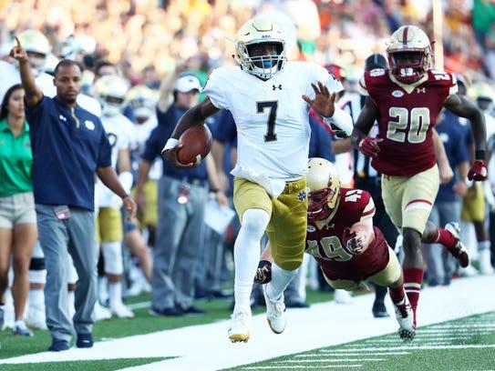 Notre Dame quarterback Brandon Wimbush rushed for more