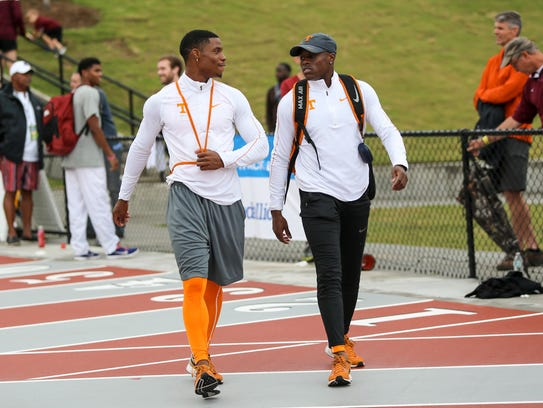Mustaqeem Williams, left, talks with Christian Coleman