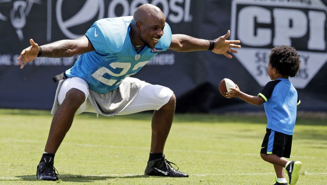 Josh Thomas, left, reaches out to hug his son Dallas on July 29, 2014.