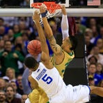 Kentucky's Andrew Harrison gets dunked on by Notre Dame's Zach Auguste in the Elite Eight game Saturday at Quicken Loans Arena in Cleveland.  The Wildcats prevailed 68-66 however and go on to the Final Four in Indianapolis.  March 28, 2015. By Matt Stone, The C-J