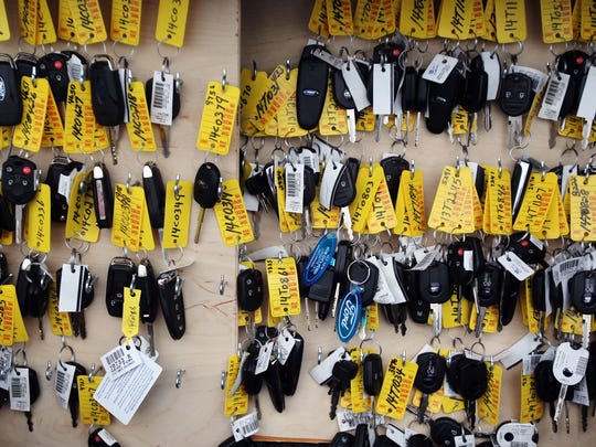 New car keys hang on a board during the Lafayette Auto Dealers Association annual carshow Friday at Cajun Field in Lafayette. The show will continue through Saturday evening.