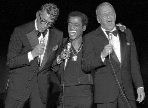 Rat Pack members Dean Martin, Sammy Davis Jr. and Frank Sinatra share a song. (Photo: 1978 AP photo)