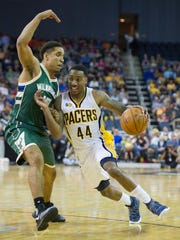 Indiana Pacers guard Jeff Teague (44) drives past Milwaukee