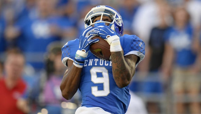 UK WR Garrett Johnson makes a 35 yard touchdown catch during the first half of the University of Kentucky football game against Louisiana-Lafayette at Commonwealth Stadium in Lexington, Ky., on Saturday, September 5, 2015. Photo by Mike Weaver