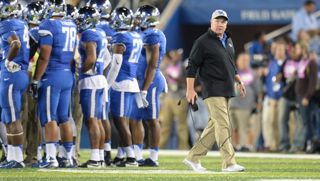 UK head coach Mark Stoops during the first half of the University of Kentucky - Auburn football game at Commonwealth Stadium in Lexington, Ky., on Thursday, October 15, 2015.