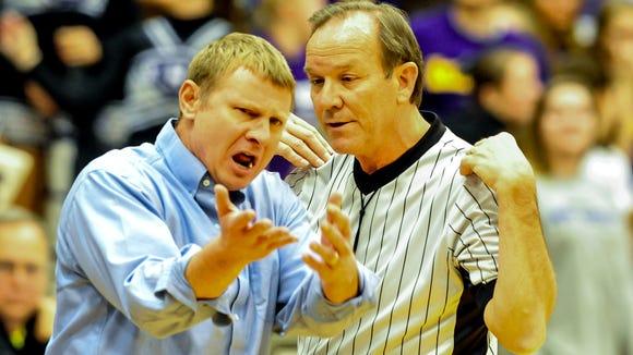 Smoky Mountain boys basketball coach Jimmy Cleavelend, left, argues a call last season..