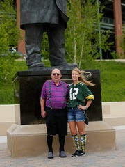 At right, Karla Ott, from Oak Forest, Ill., and her grandfather, Pete Ott, from Sheboygan, get their picture taken near the Vince Lombardi statue at Lambeau Field in Green Bay on June 16. Taking the photo was Karla's father, Mike Ott.
