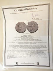 A certificate of authenticity from one of the coins anonymous donated to Salvation Army's yearly coin drive. Monday, Dec. 19, 2016.