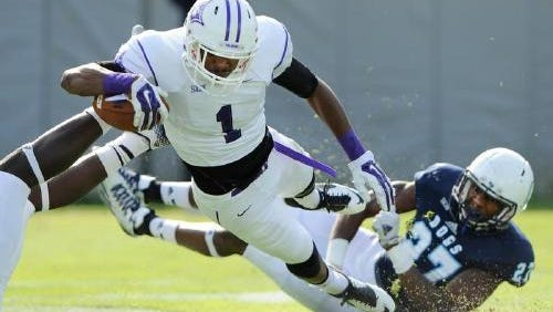 Furman receiver Jordan Snellings dives for a touchdown during the Paladins' 42-35 overtime loss at The Citadel in 2014.