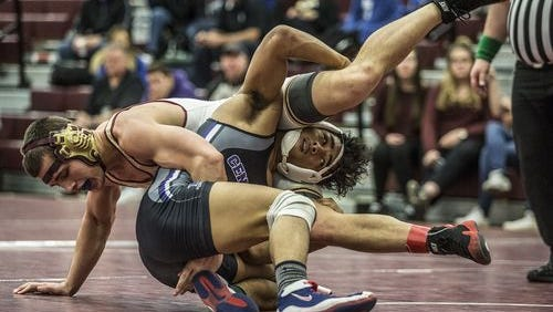Licking Heights junior Dereck Wilson battles Pickerington Central's Shota Sisco last Saturday in the 160-pound third-place match at the Newark Division I sectional.