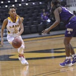 Grambling's Shakyla Hill dribbles against the Prairie View defense.