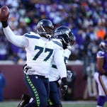 Seattle Seahawks defensive tackle Ahtyba Rubin (77) celebrates after a recovered fumble against the Minnesota Vikings in the fourth quarter of their NFC Wild Card playoff football game Jan. 10 at TCF Bank Stadium.