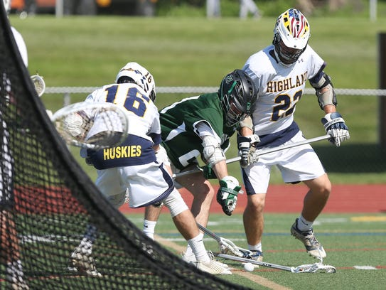 Highland's Brian Donahue, left, knocks the ball away