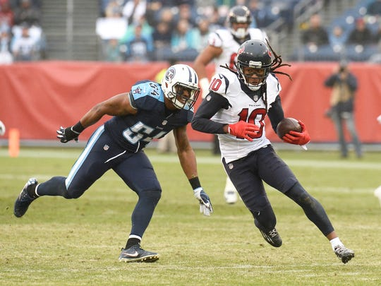 Houston Texans wide receiver DeAndre Hopkins (10) runs past Tennessee Titans linebacker Avery Williamson (54).