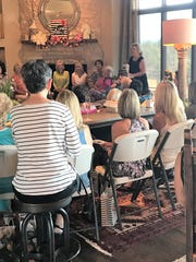 Broaddrick speaks to a group of women in Alto, New Mexico about her book.