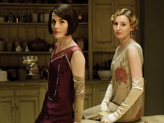 "Michelle Dockery as Lady Mary Crawley and Laura Carmichael as Lady Edith Crawley in the first episode of season 6 of ""Downton Abbey."""