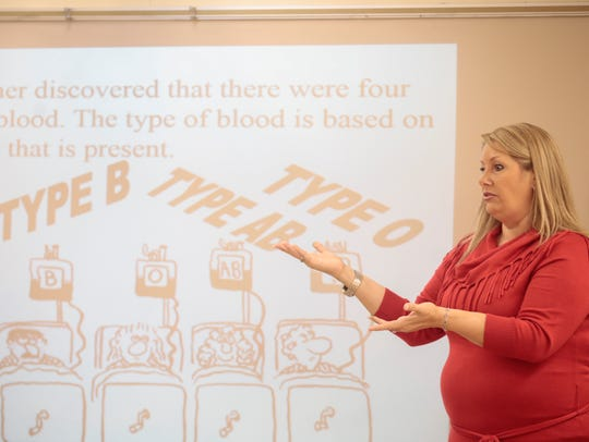 Teacher Jeanne Aguillard leads a class on plasma during a symposium at the Early College Academy in Lafayette, La. in 2016. ECA offers dual enrollment courses to students, who graduate with a high school diploma and associate's degree.