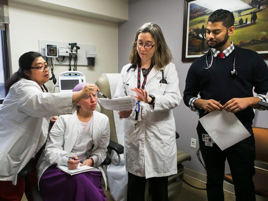 December 6, 2016 - (From left to right) Cora Guimera, RN, Nisa Harris, RN, Dr. Rebekah Kaplowitz, medical director of women's health, and Dr. Shawn Patel look over paperwork during a meeting at the Women's Health Center at the Department of Veterans Affairs Medical Center on Tuesday. Centers in Memphis and Nashville have one of a possible five stars, which is the lowest ranking.
