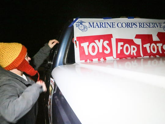 Dan Marett, III, of Anderson waits for people to donate at the Marine Corps Reserve Toys For Tots drop off at the Green Pond Boat Landing. Two dozen sailboats joined in the Western Carolina Sailing Club 2nd annual Parade of Lights on Friday, December 9th on Lake Hartwell in Anderson County and will ride by the landing Saturday nights between 6:30 p.m. and 7 p.m.
