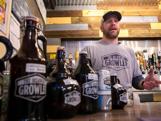 Mike Slattery, owner of The Delaware Growler in Newark, says he has sold more than 3,000 of the 32-ounce cans since buying a canning machine a year ago.