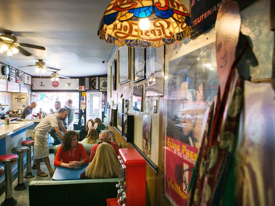 Angelo's Luncheonette owner, August Muzzi is a big Elvis Presly fan and displays his collection throughout the restaurant to include the bathroom.