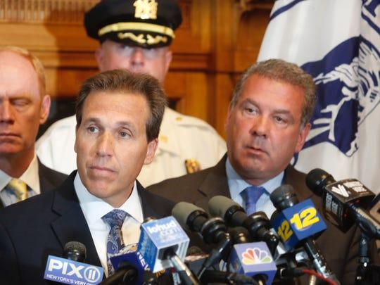 Yonkers Police Commissioner Charles Gardner, left,