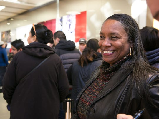 Diane Showers of Philadelphia lines up in front of the Apple Store to get gift card promotions worth up to $150 with the purchase of select Apple products on Black Friday at Christiana Mall in Newark.
