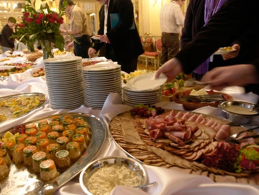 Catering, banquet, large selection of snacks on plates, old interior