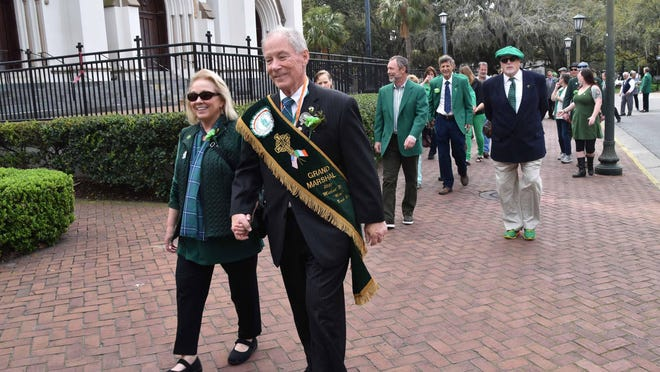 Grand Marshal of Savannah's 2020 St. Patrick's Day Parade, Mike Roush, leads a small group past the Cathedral of St. John the Baptist in an impromptu parade on St. Patrick's Day morning.