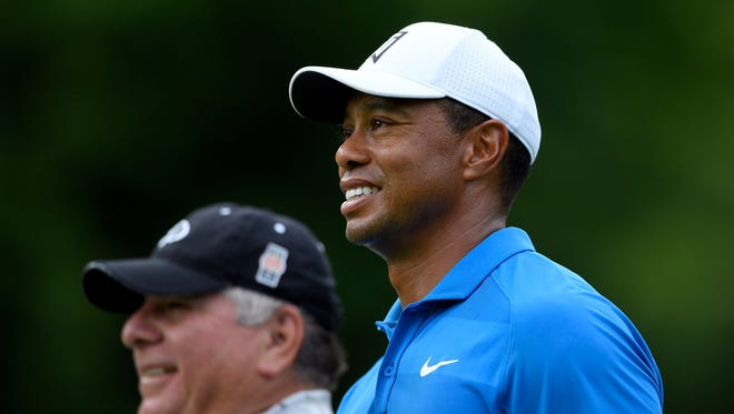 Tiger Woods smiles on the third hole during the Quicken Loans National golf tournament Pro-Am on June 27 in Potomac, Md.