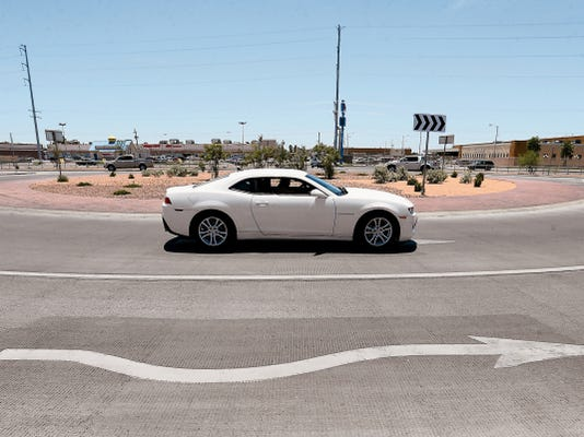 Motorists navigate the newly completed 10.5 million intersection at Paisano and Alameda. The improvements eliminated the bridge at the intersection of Paisano and Alameda as well as improved sidewalks and lighting.