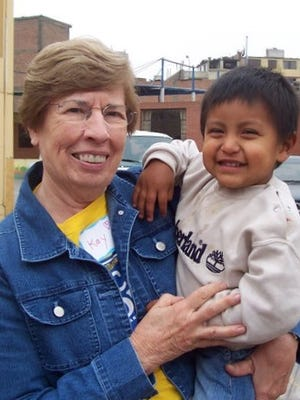 Kay Vanderkleed holds a Peruvian child during a mission trip to the South American country.