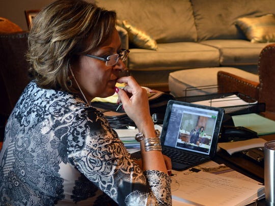 Republican New Mexico Gov. Susana Martinez watches a live stream of the Democratic-controlled New Mexico Legislature on Friday, March 17, 2017, in Albuquerque, N.M. A party-line vote in the Democrat-led House of Representatives set up a showdown with Martinez, who has pledged not to raise taxes while pushing for more belt-tightening. Martinez can veto all or portions of the budget and taxation bills.