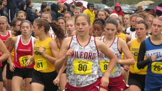 Milford's Rachel Barrett (90) leads the pack at the start of the 2013 KLAA Lakes Conference cross country meet.