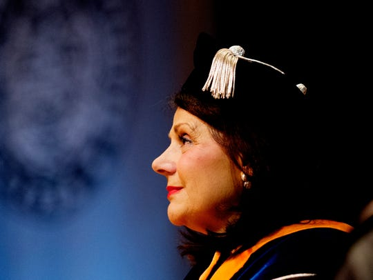 UT Chancellor Beverly Davenport listens during her