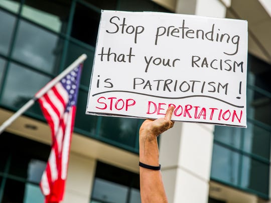 Protesters gather in front of the Collier County Courthouse in Naples on Saturday, June 30, 2018 to rally against the current immigration policies and to call for the reunification of families that were separated at Mexico's border.