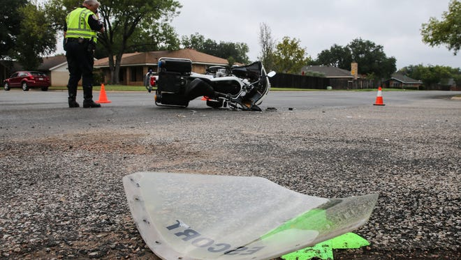 A private escort motorcycle was involved in a crash at the intersection of South College Hills and Southland Boulevard on Friday, Aug. 25, 2017.