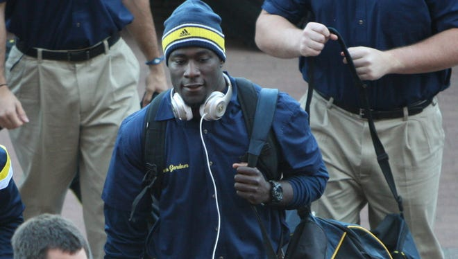 Michigan quarterback Devin Gardner arrives to the game against Penn States on Saturday, Oct. 11, 2014, in Ann Arbor.