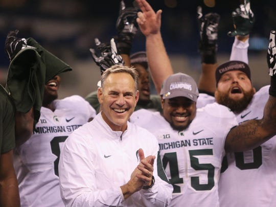 """Dantonio celebrates after the win over the Iowa Hawkeyes in the Big Ten Championship on December 5. """"Things need to be run correctly, and they need to be all going the same direction,"""" Dantonio said."""