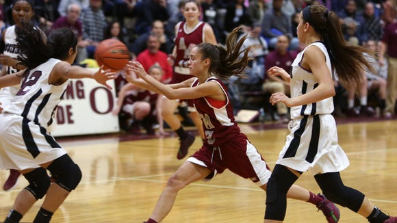 Alberts Magnus' Dani LaRochelle  gets a pass off under pressure against Ossining  during their game at Ossining High School on Wednesday.