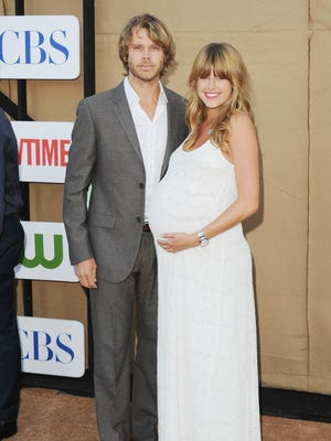 Eric Christian Olsen and actress Sarah Wright on July 29 in Beverly Hills.