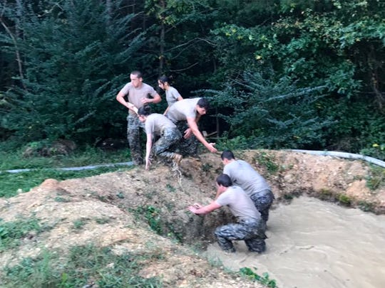 Fairview JROTC cadets race through a mud pit during the Steeple Chase event at the State Championship challenge.