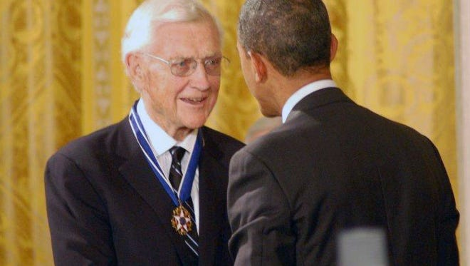 President Barack Obama presents John Doar with the Medal of Freedom, the nation's highest civilian honor. Doar died Tuesday at the age of 92.