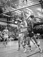 Mike Muchowski tries to shoot against Beaver Dam during Manitowoc's sectional semifinal victory at JFK Fieldhouse. The Ships would go on to win the 1968 state championship.