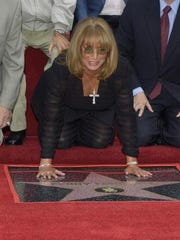 Actress-director Penny Marshall attends the ceremony honoring her and actress Cindy Williams each with a star on the Hollywood Walk of Fame on August 12, 2004 in Hollywood, California.