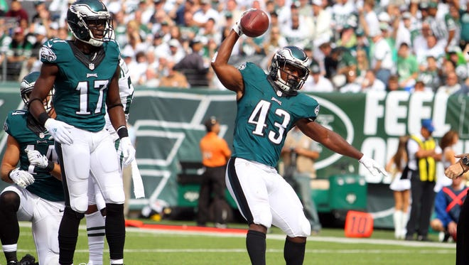 Philadelphia Eagles running back Darren Sproles (43) celebrates a touchdown against the New York Jets during the second quarter at MetLife Stadium.